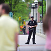 """An officer patrols the Broadway St. bridge over Boulder Creek in downtown after a shooting in Central Park. A man reportedly fired shots then pointed his weapon at Boulder police who shot him. <br /> More photos:  <a href=""""http://www.dailycamera.com"""">http://www.dailycamera.com</a><br /> Autumn Parry/Staff Photographer<br /> May 22, 2016"""