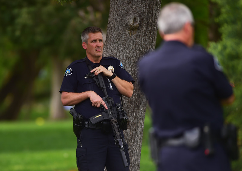 "Boulder police officers patrol the Boulder Creek area in downtown after a shooting in Central Park. A man reportedly fired shots then pointed his weapon at Boulder police who shot him. <br /> More photos:  <a href=""http://www.dailycamera.com"">http://www.dailycamera.com</a><br /> Autumn Parry/Staff Photographer<br /> May 22, 2016"