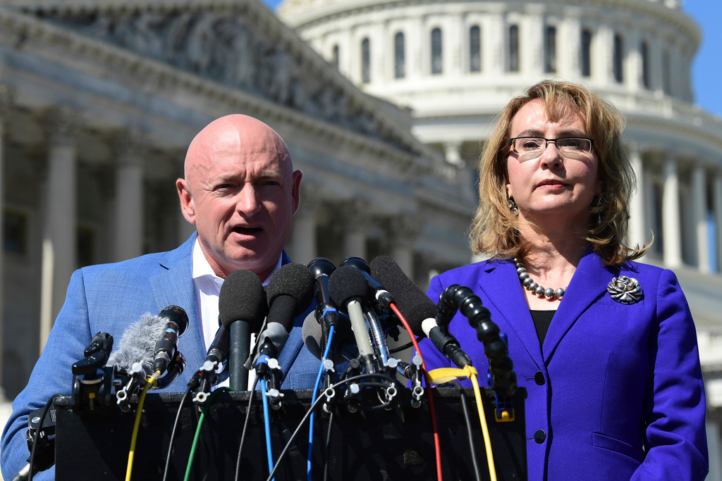 . Former Rep. Gabrielle Giffords, D-Ariz., right, listens as her husband Mark Kelly, left, speaks on Capitol Hill in Washington, Monday, Oct. 2, 2017, about the mass shooting in Las Vegas. Giffords, was a congresswoman when she was shot in an assassination attempt in 2011. (AP Photo/Susan Walsh)
