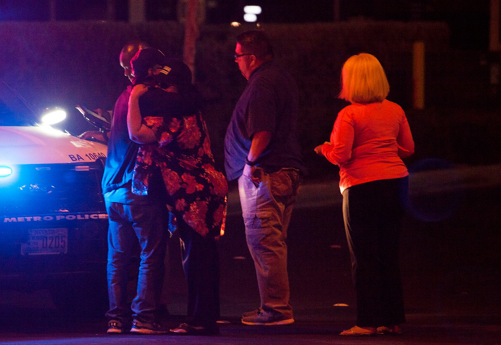 . People embrace after arriving at Metro Headquarters to check on loved ones early Monday, Oct. 2, 2017, after a mass shooting at a music festival on the Las Vegas Strip Sunday. (Yasmina Chavez/Las Vegas Sun via AP)