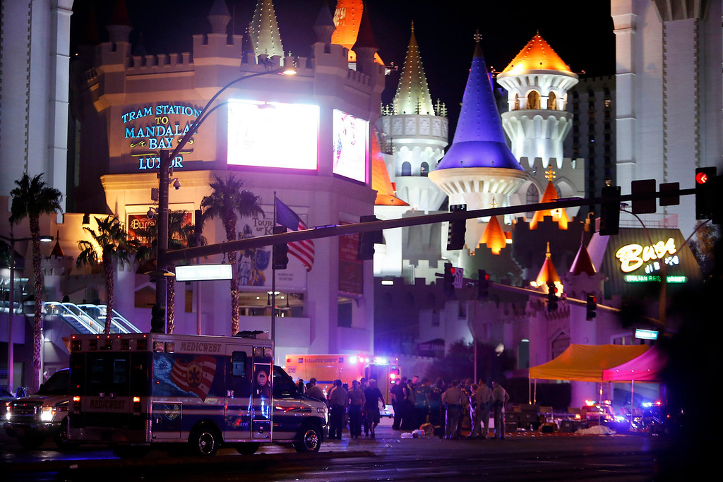 . Las Vegas Metro Police and medical workers gather at an intersection after a mass shooting at a music festival on the Las Vegas Strip on Sunday, Oct. 1, 2017. (Steve Marcus/Las Vegas Sun via AP)