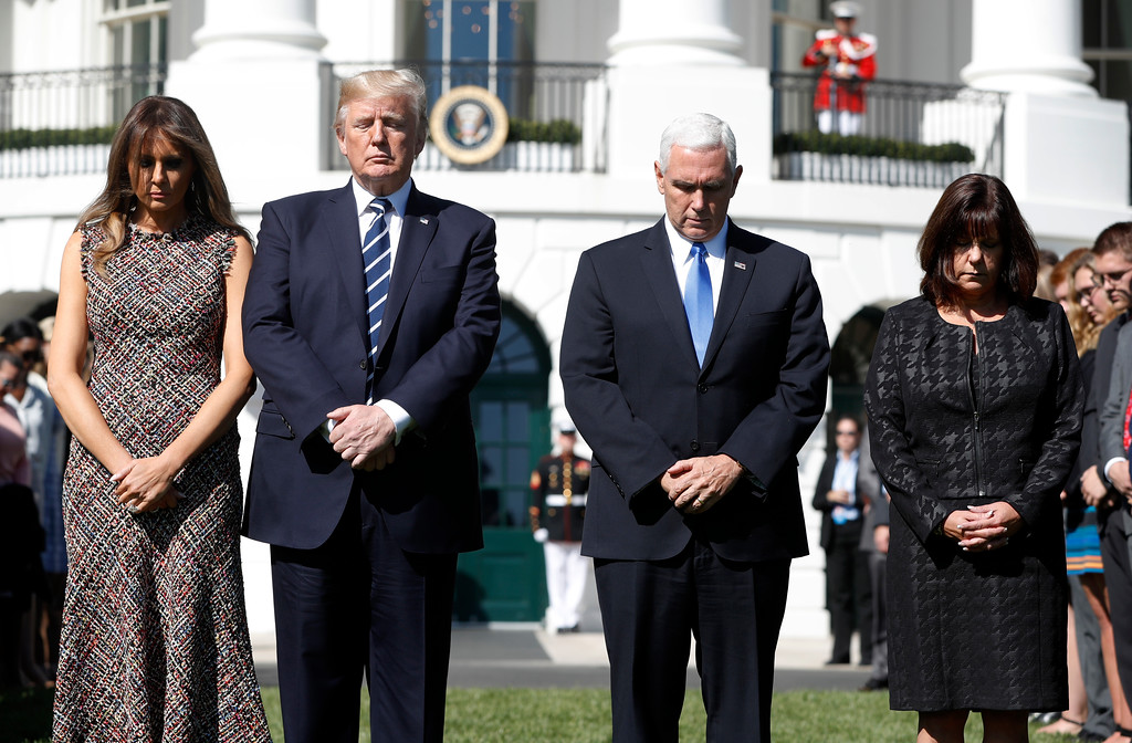 . President Donald Trump and first lady Melania Trump stand with vice president Mike Pence and his wife Karen during a moment of silence to remember the victims of the mass shooting in Las Vegas, on the South Lawn of the White House in Washington, Monday, Oct. 2, 2017. (AP Photo/Pablo Martinez Monsivais)