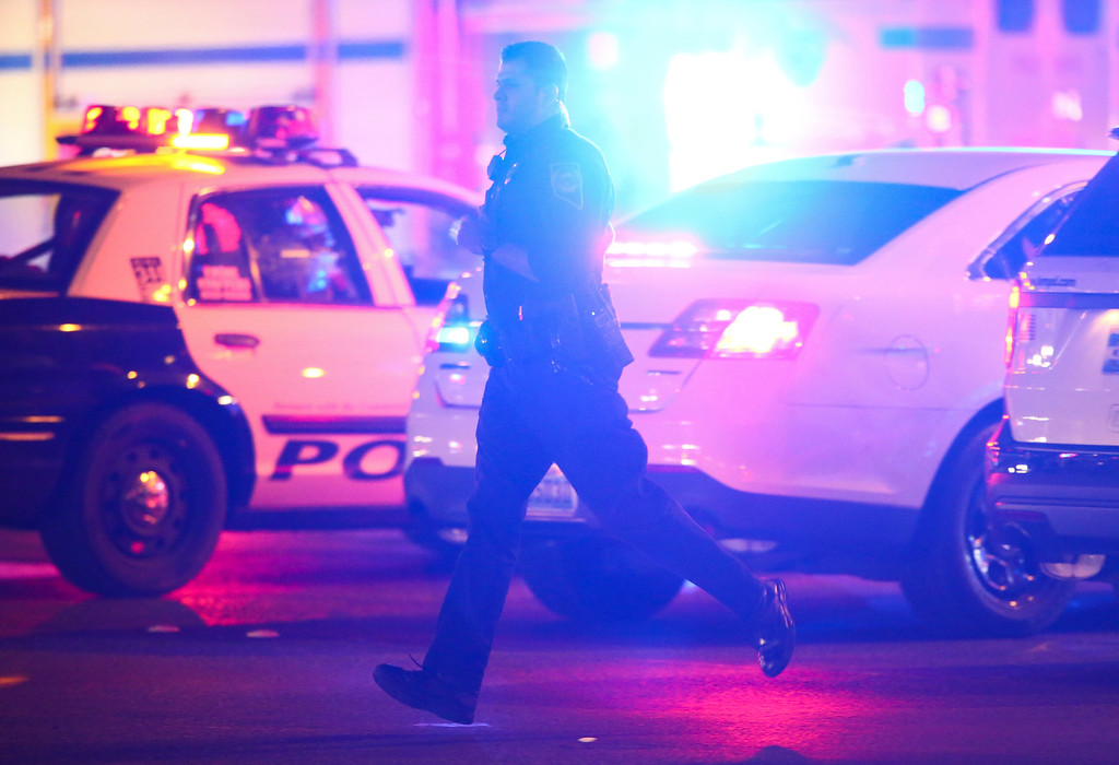 . Las Vegas police respond during an active shooter situation on the Las Vegas Strip near Tropicana Avenue in Las Vegas Sunday, Oct. 1, 2017. Multiple victims were being transported to hospitals after a shooting late Sunday at a music festival on the Las Vegas Strip.  (Chase Stevens/Las Vegas Review-Journal via AP)