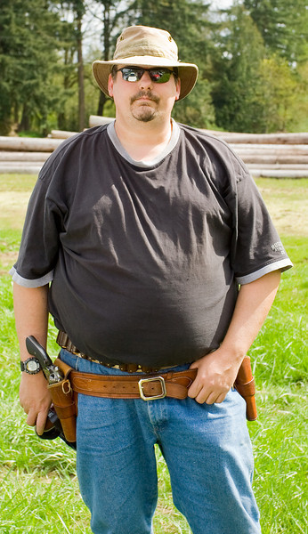 Your humble photographer with sixguns and none to authentic western wear.  He also is in need of weight loss.  ;)