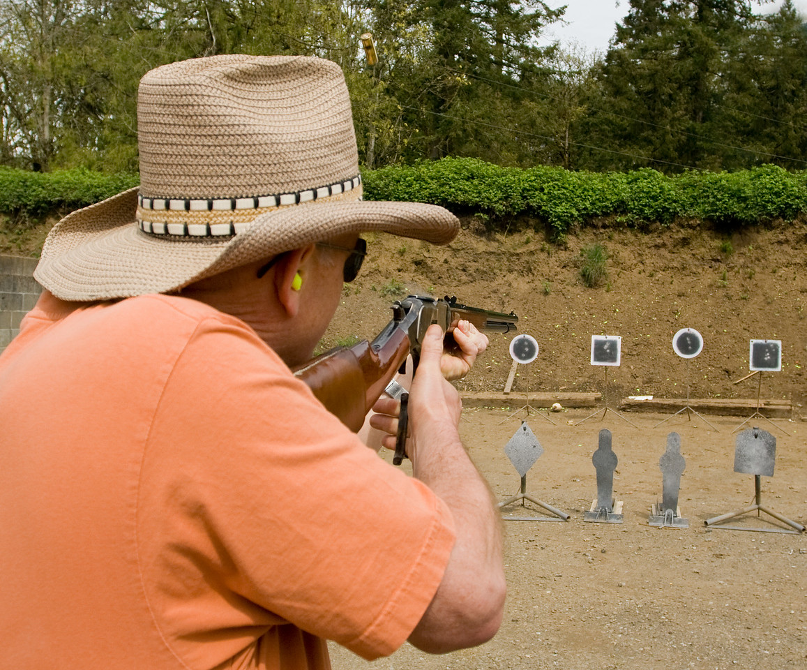 A student using the rifle on some black hat wearin' types.