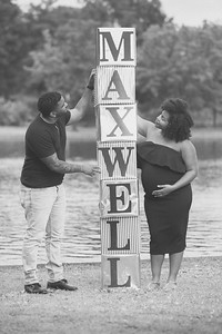 The couple poses for a portrait at their maternity session at Byrd Park in Richmond, Virginia.