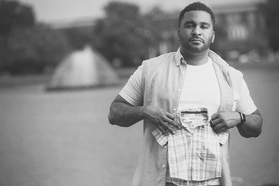 Maurice poses for a portrait during the maternity session at Byrd Park in Richmond, Virginia.