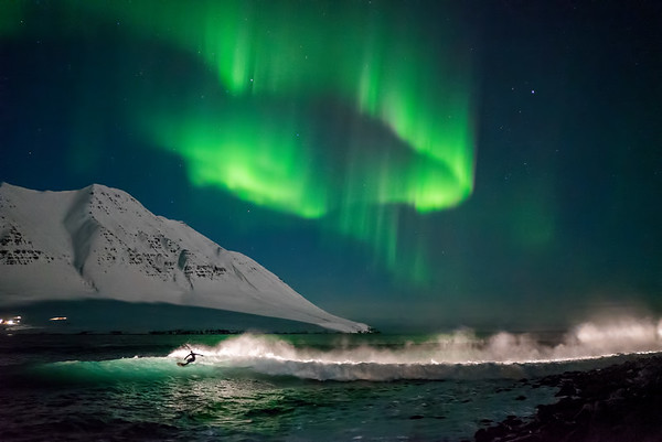 Timmy Reyes surfing under the Aurora Borealis