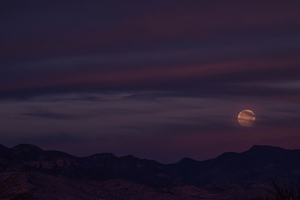Full Moon setting over The Huachuca Mountains