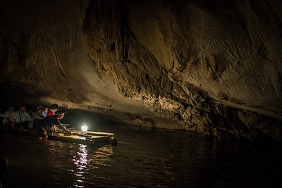 Bamboo rafting through a cave near the town of Pai, Thailand