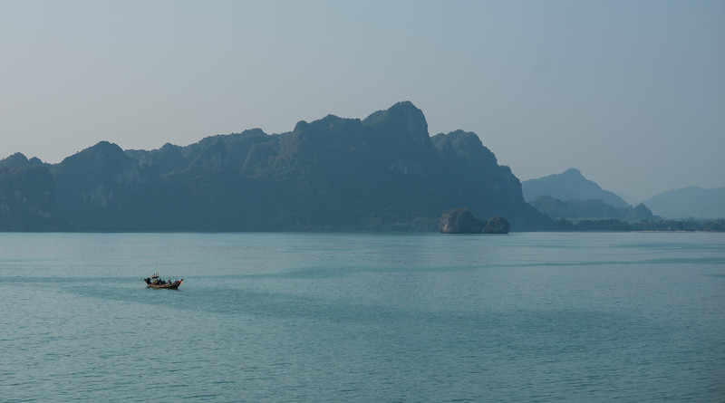 A Thai longtail boat floating by Surat Thani, Thailand