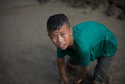 Thai boy planting rice