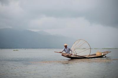 Burmese fisherman resting on Inle Lake, Myanmar