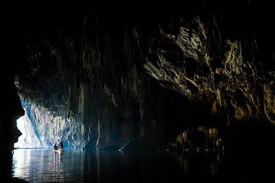 Bamboo rafting through a cave near Pai, Thailand