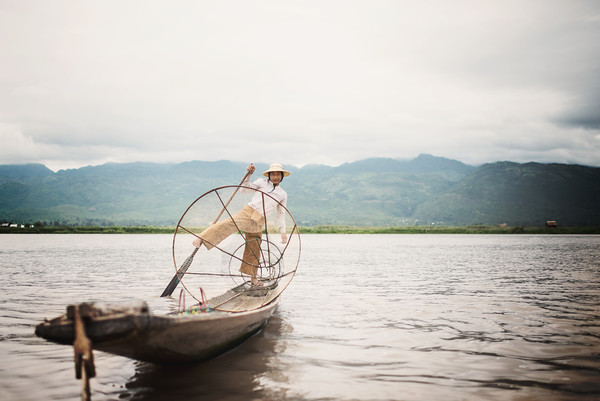 A young Burmese fisherman on Inle Lake, Myanmar
