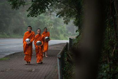 Adolescent monks gathering their morning donations