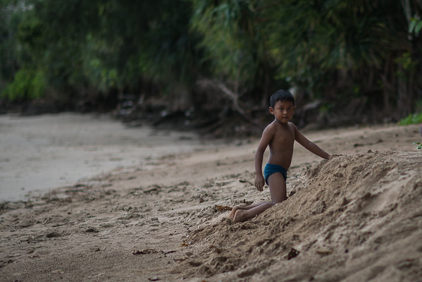 A Koh Lanta native playing on an empty beach