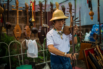 Vendor selling traditional Thai instruments in Chiang Mai, Thailand
