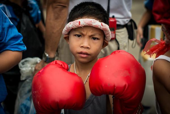 Thai boy getting ready for the village sport day festival