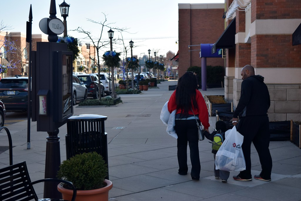 . Shoppers hunt for deals during Black Friday at the Village of Rochester Hills on Friday, Nov. 24, 2017.