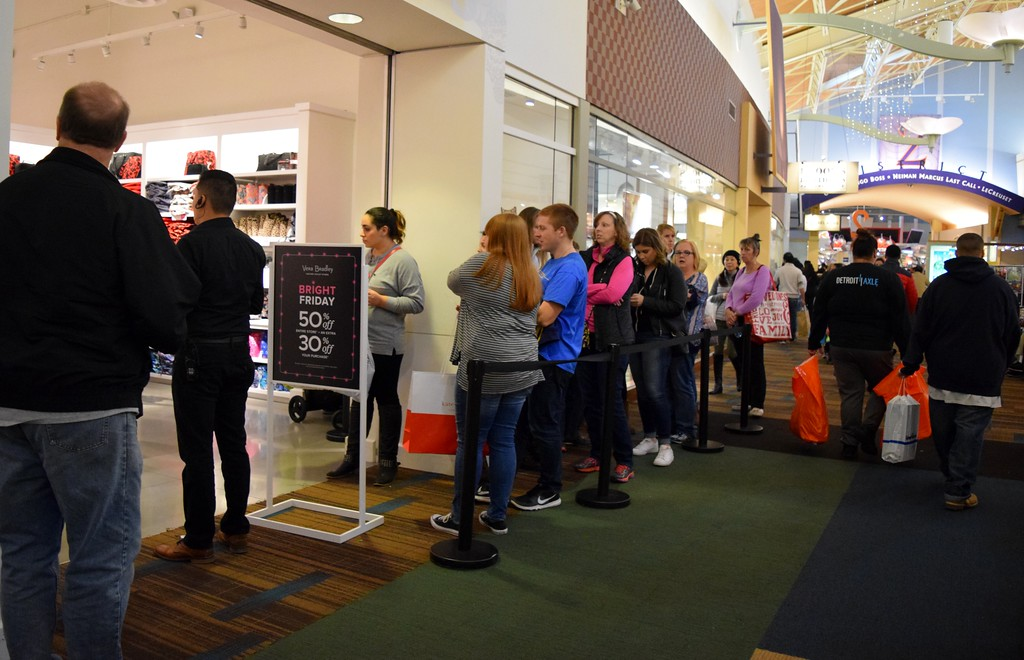 . Shoppers hunt for deals during Black Friday at Great Lakes Crossing Outlets on Friday, Nov. 24, 2017.