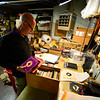 KRISTOPHER RADDER — BRATTLEBORO REFORMER<br /> Patrick Pezzati, the owner of Turn It Up, on Main Street, in Brattleboro, Vt., goes through records to fill online orders as the store is closed because of COVID-19 on Wednesday, April 22, 2020. Pezzati said he was not able to get a small business grant from the first stimulus package.