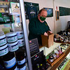 KRISTOPHER RADDER — BRATTLEBORO REFORMER<br /> Scott Sparks, Owner of Vermont Hempicurean, in Brattleboro, Vt., fills an online order on Wednesday, April 22, 2020. Sparks was able to secure a small business grant from the first stimulus package.