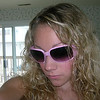 Casey in her famous pink sunglasses.