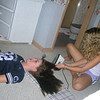 """Amber and Casey getting ready for the night.  Amber forgot her hair straightener so Casey decided to actually iron her hair.  Casey said, """"This is the ultimate test of friendship."""""""