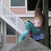 "Summer of 03'. Reading on the lower deck. Casey often ""perched "" here to read and get a view of the beach in this peaceful spot."