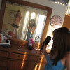 6-10-06. The girls  had arrived at the shore house and were getting ready in the upstairs bedroom. Casey took a pictue in the mirror with the clock conveniently displayed to document the moment.