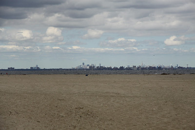 Clear @ sea and ground level despite a heavy overcast.  Looking North-East at Brooklyn with Manhattan skyline beyond.