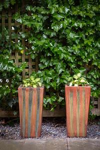 2 orange planters