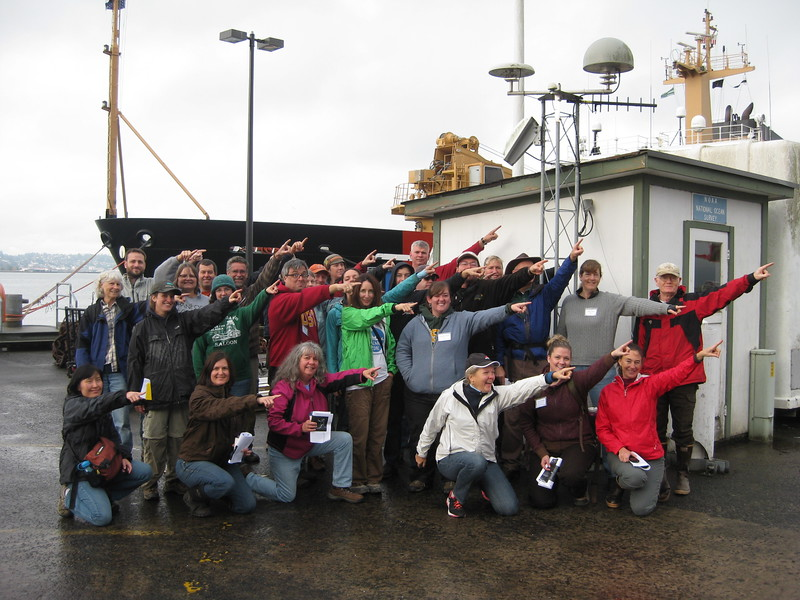 CEETEP participants from the October 2013 workshop at GPS station TPW2 (Astoria, Oregon) showing the direction of plate motion relative to stable North America (northeast). (Photo/Rachael Hausmann, OSU)