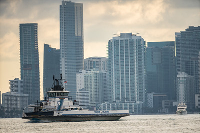 500mm telephoto Fisher Island Ferry in bay with downtown Brickell Miami in background