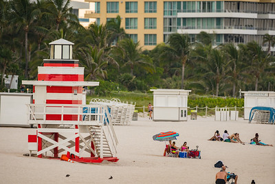 Tourists by Miami Beach lifeguard hut