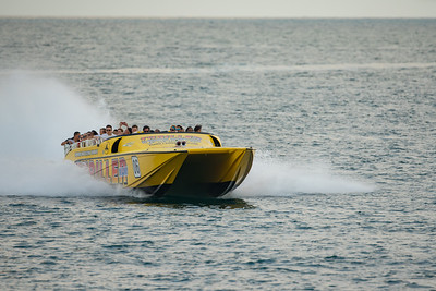 Thriller Miami speedboat with tourists excited for speed