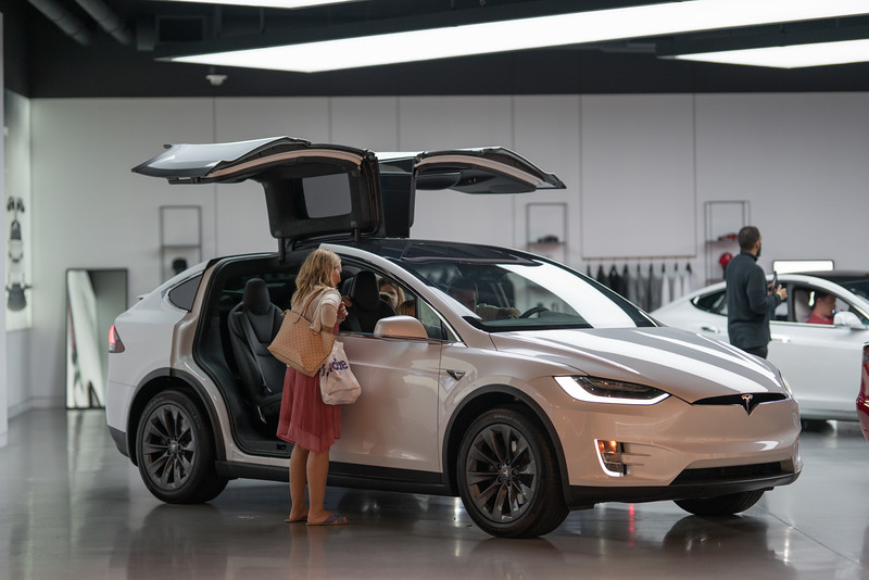 Family shopping for a new Tesla Model x at the Aventura Mall showroom