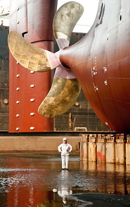 The assistant poses under the prop/rudder.The prop is 10meters in diameter and weighs 50t.