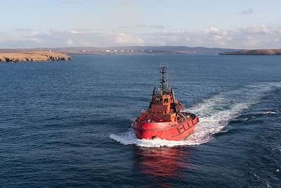 The escort tug follows us out of Sullom Voe