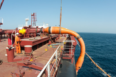 Loading cargo in the Persian gulf,the oil comes in via the two floating hoses,it can be pretty quick with rates of up to 12 000 tons per hour.