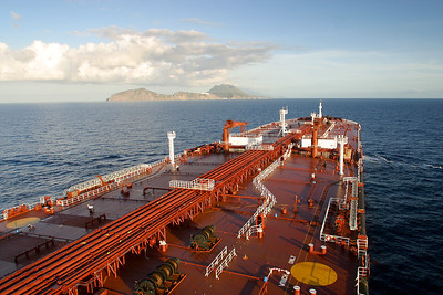 333 meters long,58 meters wide with a loaded draught of 22.5 meters.We carry just over 2 million barrels of crude oil,and fully loaded we displace 360 000 tons.Full speed we use 110 mt of fuel a day.Everything about these ships is BIG