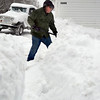 HOLLY PELCZYNSKI - BENNINGTON BANNER Mike Gahan, of Woodford shovels snow from his driveway on Wednesday morning.