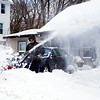 HOLLY PELCZYNSKI - BENNINGTON BANNER Fred Macdonald, of Bennington helps out an older neighbor by snow blowing their driveway on Wednesday morning after a blizzard brought two feet of snow to Bennington and surrounding areas.