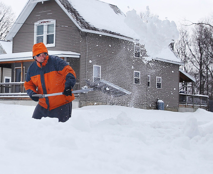 HOLLY PELCZYNSKI - BENNINGTON BANNER Jon Grimsley, of Bennington shovels out of his driveway on Wednesday morning after snowstorm Stella dropped two feet of snow on Bennington.
