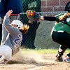 WARREN  DILLAWAY | Star Beacon <br /> Grand Valley's Taylor Hall slides safely home on Monday afternoon as Lakeside catcher Nicole Lemponen makes a late swipe tag at Lakeside.