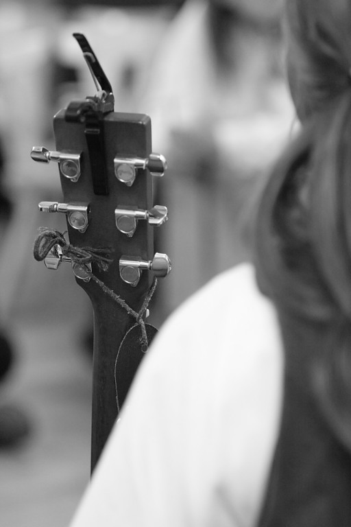 The head of a lute shot over the shoulder of the owner.