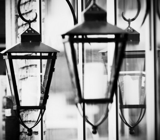 I saw these old laterns hanging in front of a store, reflecting in the shop windows.  Rendered in black and white  they look even more authentic.