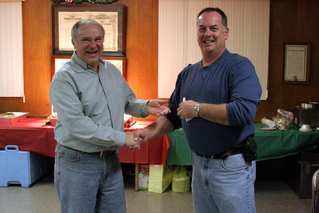 Dave Barretto accepts lifetime member pin