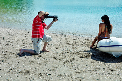 A photographer and his model on the beach, Bay of Islands